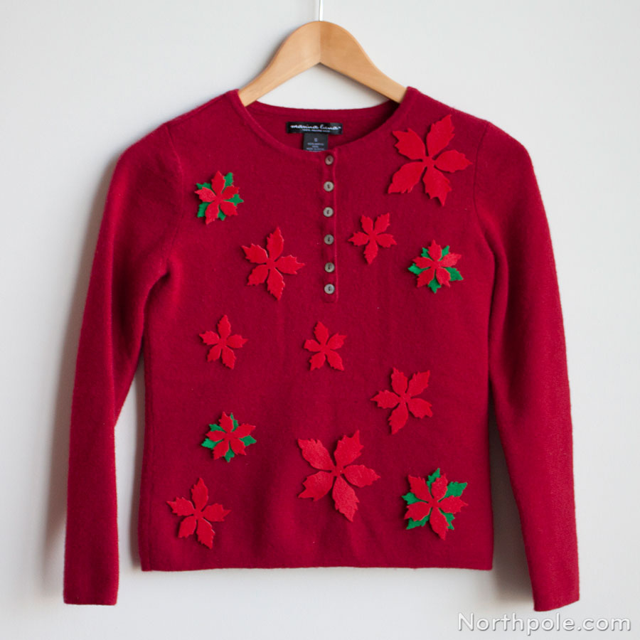 A sweet Christmas sweater with red poinsettias.
